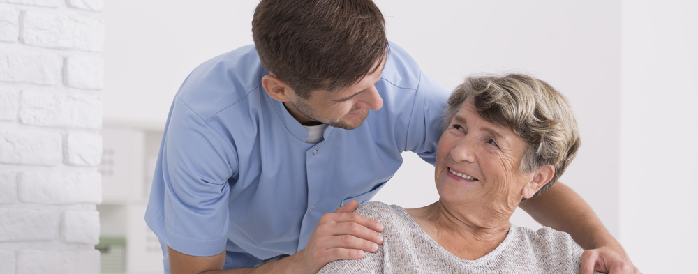 Caregiver connecting with senior