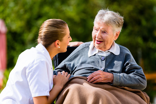 Caregiver providing assistance with activities of daily living