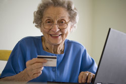 Senior paying for services from online portal at home.