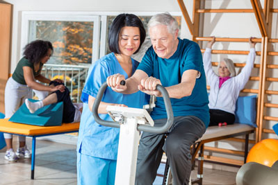 HHA helps elderly man with physical therapy