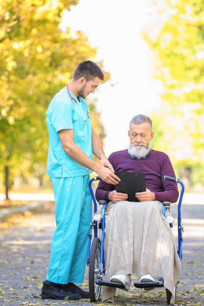 Male home health aide provides senior with assistance