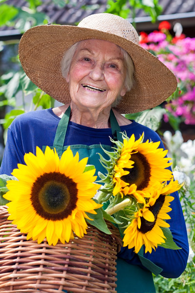 Elderly woman enjoying gardening activities